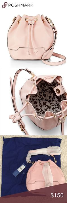 """BRAND NEW Rebecca Minkoff Mini Fiona Bucket Bag Genuine, brand new with tags and dust bag( see pictures). Purchased from gilt and have never used!! 7"""" H x 10"""" W x 5"""" D. Quartz color. Light gold hardware. Interior pockets. Rebecca Minkoff Bags Crossbody Bags"""