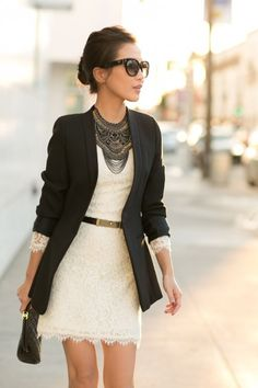 a jacket with a simple dress, + neckless + clases and a bun. Clean colours and minimalism. Black and white