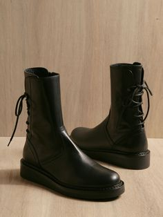Ann Demeulemeester. They make faux leather knock offs, but I'd rather not own them at all than disrespect the Ann D. name.