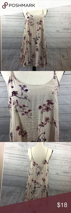 Brandy Melville Floral Dress Brandy Melville tan dress with purple floral details. Dress is semi sheer--if you wear dark under garments it will be seen, however not lights colored ones. Has adjustable straps. Super light and flowy. Brandy Melville Dresses