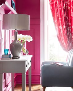 This Fearne Cotton room is stunning. Bright pink walls meets classically stylish furniture. The occasional chair complets the look.