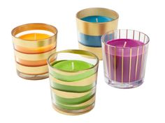 Striped Votive Candles - Votive holders with candles: Sinnlig scented candle in glass in orange, green, turquoise, and lilac, $2 each, IKEA stores; Spray paint: Bright Coat Gold by Rust-Oleum