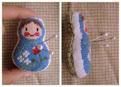 A make-your-own matryoshka cross-stitch pin cushion. So cute!