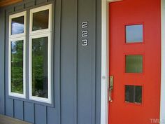 Red Door With a Cool Medium-Gray House Color I love the contrast between the vibrant, pure red color of this door and the more muted blue-gray color of the siding. The white trim adds crispness. Also...love the door.