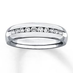 14K White Gold 1/2 Carat t.w. Diamond Band.  My dad rocks a similar band. I think I can pull this off.