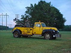 Old Yellow Tow Truck/ Towing Insurance for over 30 yrs. www.TravisBarlow.com
