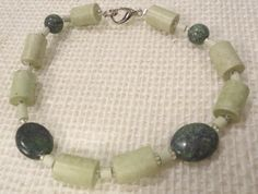 Natural Woodland Muted Green Bracelet Russian by EducationAndMore, $15.00 Natural and so softly muted woodland green tones of Russian Jade and soft green vintage ceramic beads. Not a big statement just a beautiful minimalistic Fair Trade bracelet.  A beautiful gift for you or a special friend.