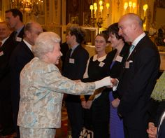 Queen Elizabeth II meets Pat O'Connell (R) at the Irish Community Reception at Buckingham Palace on March, 25, 2014. The reception is in a advance of Ireland's President Michael D Higgins who will be the first Irish President to pay a state visit to Britain in April.