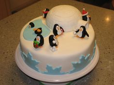 - Chocolate cake with vanilla buttercream. Covered in MFF (Michele Foster's Fondant recipe). The igloo is also cake (Wilton sports ball pan with some additional shaping/carving) covered in fondant. The penguins are all fondant.