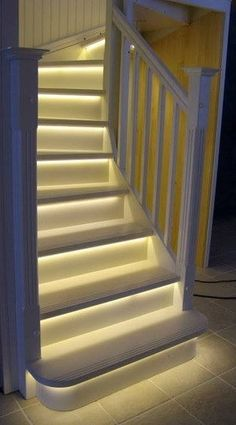 LED light strips on stairway with more info at: www,DreamDecorator.blogspot.com/2013/05/led-light-strips-on-stairway.html and image via www.Facebook.com/pages/Dream-Decorators/584875848206780