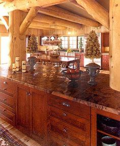 Range Encased Stone Hearth, Knotty Alter Cabinets and Island Hammared Copper Countertop Rustic Kitchen Pictures