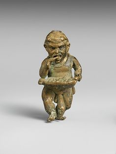 Bronze statuette of a dwarf with silver eyes  Period:     Late Hellenistic or Early Imperial Date:     1st century B.C.–1st century A.D. Culture:     Greek or Roman Medium:     Bronze