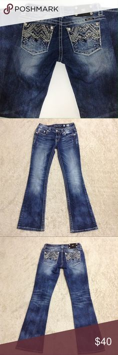 Miss Me Boot Cut Jeans Miss me jeans boot cut with bling back pockets .the back is splotchy as pictured above. Overall good condition size 27 inseam 31 Miss Me Jeans Boot Cut