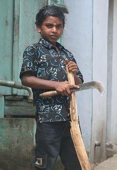 Knife Boy, Munnar, Kerala.  India.
