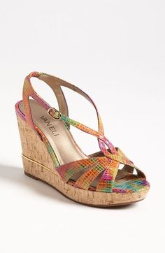 "Sinuous straps curve and wrap atop a comfortable sandal lifted with a metal-inset cork wedge. A rainbow of color makes these stripy sandals a cheerful way to walk through summer.   Approx. heel height: 3 3/4"" with 1"" platform."
