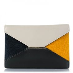 This is an authentic CELINE Pony Hair Calfskin Diamond Compact Multifunction Wallet in Pearl Grey. This luxurious clutch is crafted of calfskin and pony hair in a stylized diamond design with a prominent pointed flap.