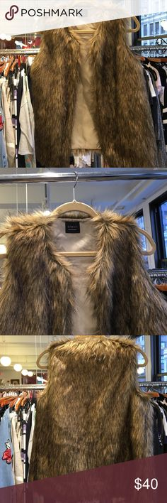 Faux fur vest NEW but without tags Beautiful faux fur vest from our showroom! Perfect for this upcoming fall/winter season! Jackets & Coats Vests