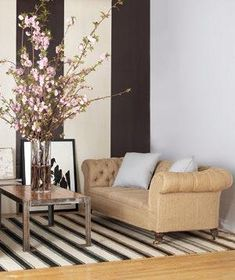 Enliven a couch with an inexpensive material, such as burlap, giving it surprising character.