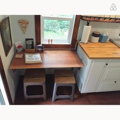 Eating nook with bench seats that have multi purpose uses. Use them as dining chairs, steps stools or couch side tables. Table also folds down for more space as well. - Get $25 credit with Airbnb if you sign up with this link http://www.airbnb.com/c/groberts22