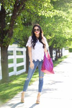 White lace top, ripped skinny jeans, nude wedges, and pink hobo bag.