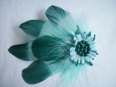 Aqua & Teal Dip Dyed Feather Hair Clip, Order Now from www.indigodaisyweddings.co.uk Specialising in stunning bespoke cocktail fascinators and formal hats in a wide range of colours, perfect for Royal Ascot and The Kentucky Derby. Plus all your wedding floral accessories including shoe clips, bandeau veils,vintage flapper bands, feather and flower fascinators, feather fans, fairy wands, wrist corsages, wedding bouquets & buttonholes. Worldwide Delivery.