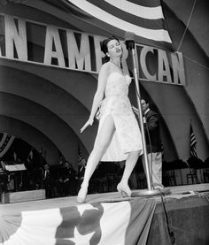 "Yvonne De Carlo performing on stage at ""I am an American"" Day at The Hollywood Bowl, 1951."