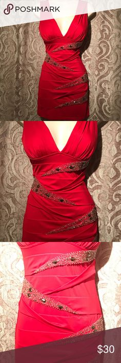 Sexy Red Ruched Mini Dress This is a classic ruched Niki Biki dress that flatters instantly when you put it on. The dress has beautiful rhinestone detailing throughout and best of all it is bra friendly! It's in great condition. Size small. Nikibiki Dresses Mini
