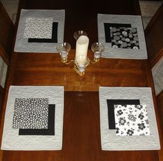 Modern Grey Placemats, Set of 4 Black White and Grey Placemats, Shadow Table Linens, Placemats for Modern Decor, Gray Place Mats  ------------------------------------------------------------- These modern-look placemats will give an updated look to your dining room or kitchen table. The black, white and grey colors would suit many decors. The placemats could also be used to protect a sideboard, server, coffee table or end tables or bedroom furniture.  Each placemat features one of four…