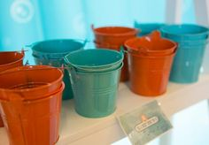 Octonauts Party with Lots of Fun Ideas via Kara's Party Ideas. Treat pails, orange and turquoise blue.