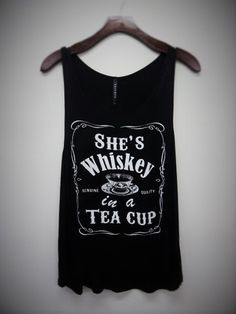 She's whiskey in a teacup tank top A fun tank for you or a great gift for a friend! Runs true to size. 95% rayon 5% spandex