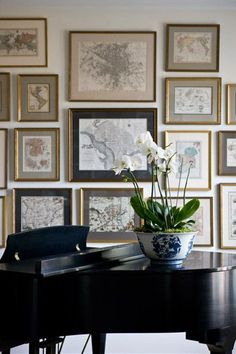 Beautiful map gallery wall. Great idea to frame old maps of places you have traveled.