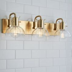 For vanity in master bath? Cut Round Flask Bath Light - 3 Light from Shades of Light Vanity Light Bar, Vanity Lighting, Bar Lighting, Vanity Bar, Modern Lighting, Lighting Ideas, Modern Farmhouse Bathroom, Industrial Bathroom, Industrial Table