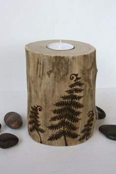 A lovely large tealight holder made from a salvaged driftwood log. Three woodland ferns have been freehand burnt into the wood! Lightly sanded to enchance the natural beauty of each piece. It measures 5 1/2 inches tall and is a wide 4 inches across the top.  A wonderful way to add some woodland charm to your decor! Carefully wrapped with a tealight included.