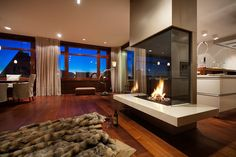 I love that modern fire place.