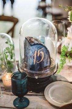 Great idea for table numbers! Agate slice table numbers under a cloche.