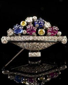 PAUL EMIL BRANDT -Art Deco jardiniere brooch, set with brilliant cut diamonds, two fancy yellow diamonds, two cut sapphires and two cut rubies-France