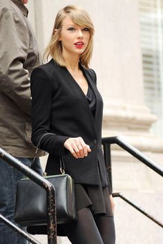 Taylor #Swift- Flawless in monochrome #black with Dolce & Gabbana bag