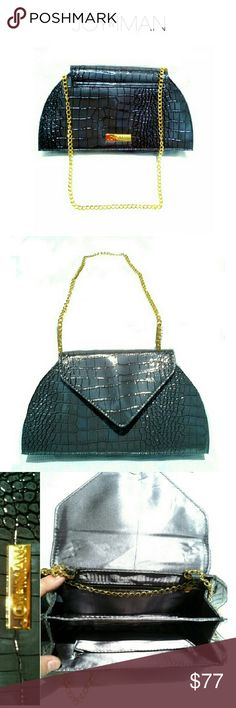 """JOY & IMAN GRAY CHAIN SHOULDER BAG  NWOT JOY & IMAN GRAY CHAIN SHOULDER BAG *.  2 SEPARATE COMPARTMENTS/ MIDDLE CC SLOTS *.  INSIDE SIDE ZIPPER COMPARTMENT / POUCH *.  OVERLAP MAGNETIC CLOSING *.  GOLD CHAIN CAN CONVERT TO ONE STRAND OR TWO           * 1 STRAND. DROP 23""""           * 2 STRAND  DROP 11"""" *.  H 6 1/2"""" X  BOT.L 12"""" TOP  L 7 1/2"""" *.  100% POLYURETHANE  CLASSY & JET SETTER BAG! JOY & IMAN Bags Shoulder Bags"""
