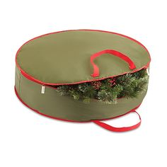 Store a decorative holiday wreath inside of the Real Simple 36-Inch Holiday Wreath Storage Bag. This red bag is durable and can be easily collapsed for when your wreath is in use.