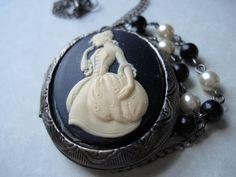 Remnants of Port Royal. Locket. Cameo. Vintage. Inspired. Necklace. Blue Goldstone. Glass Pearls. Gunmetal. Grey. Navy. Ivory. Victorian.. $30.00, via Etsy.