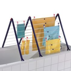 Bath Tub Drying Rack by leifheitus.com via realsimple: This roomy rack stands securely on the sides of the tub and folds away for compact storage. #Laundry_Rack #leifheitus #realsimple