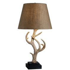 Big Buck's majestic eight point trophy celebrates the regal buck. This intricately carved antler lamp is beautifully branched and mounted on a stepped black base.