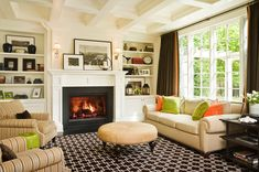 White built-ins + black fireplace surround Medina Interior Design by GR Interiors