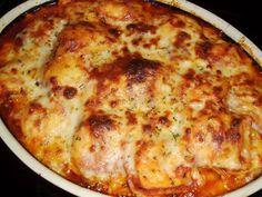 Baked Ravioli Ingredients: 1 25 oz. (1 lb) frozen cheese ravioli 1 24 oz. jar marinara or spaghetti sauce 1 lb. ground beef 1 tsp. dried basil 1 T. minced garlic 1/2 tsp. dried parsley 8 oz. shredd...