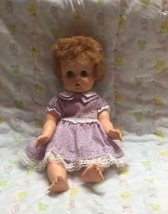 Vintage baby doll plastic doll purple dress eyes open and close play toy by Bayleesncream on Etsy https://www.etsy.com/listing/267440631/vintage-baby-doll-plastic-doll-purple