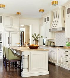 Appliances might be more intelligent, efficient, and feature-packed than ever, but that doesn't mean they're grabbing the spotlight in today's kitchen. Here, the fridge is hidden behind matching cabinet doors at the end of the island to maintain a cohesive look in this traditional kitchen.