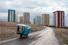 Elazig, East Anatolia: Empty Highlands. The cart of a dealer on the road  And behind some of those 290,000 apartments - http://www.geo.de