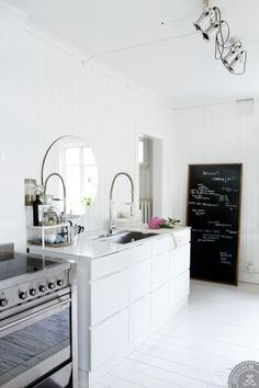 big leaning chalkboard - if you can't commit to painting the wall, paint an old door or piece of plywood & lean (or hang) it