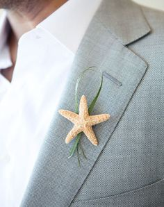 Starfish Boutonniere - A small starfish and bit of grass decorated groom Sebastiens lapel to fit the beach theme of his wedding in Islamorada, Florida. Description from pinterest.com. I searched for this on bing.com/images