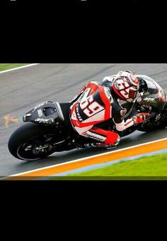 Nicky Hayden testing the 2014 Honda RC-V 1000R at Valencia with flames coming out of the exhaust! Awesome shot!